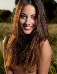 Model lorena g in a field with a flower