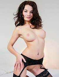 Model nici in stockings and suspenders